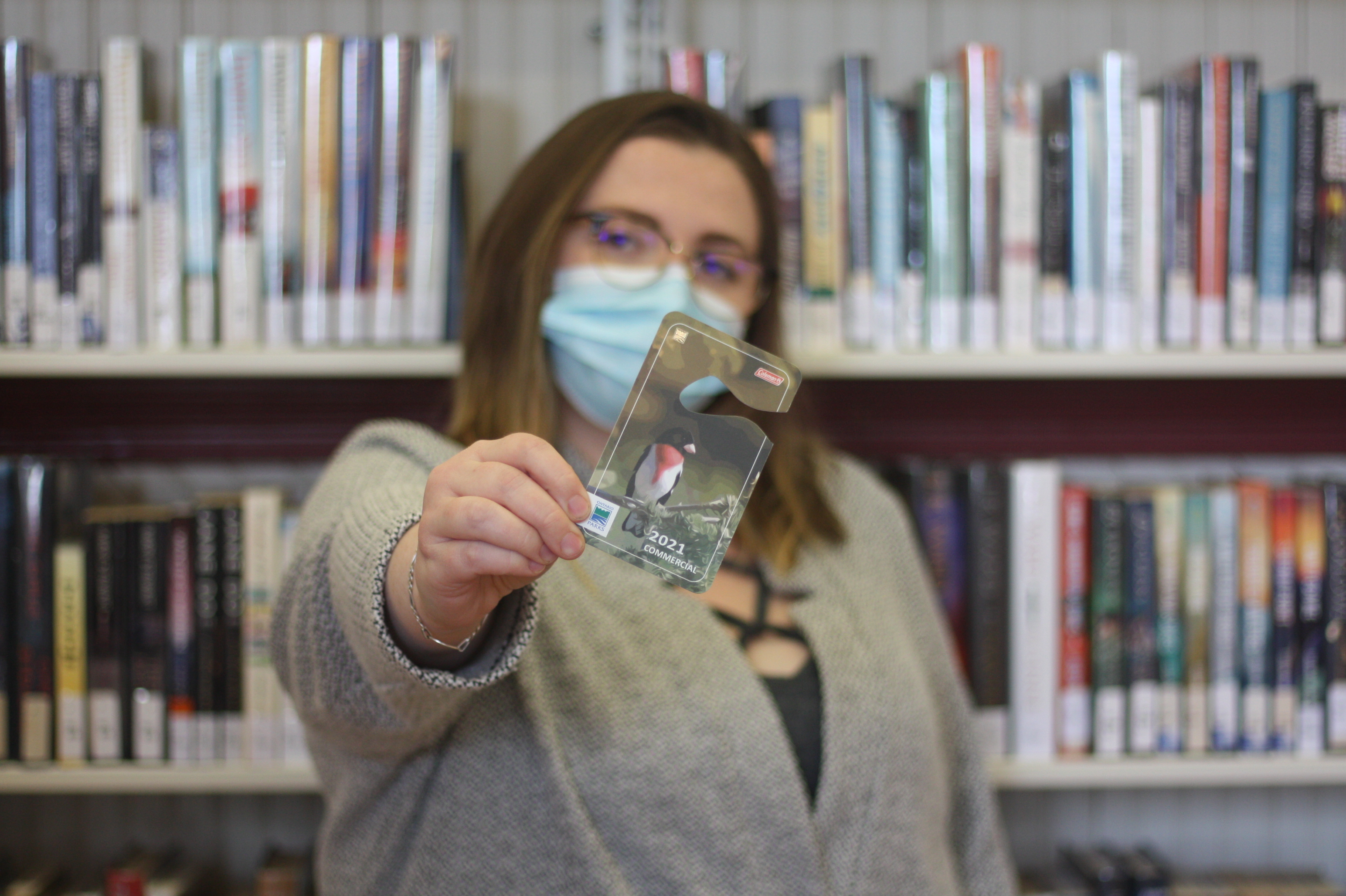 Branch Assistant Leena Bourne holds an Ontario Parks Pass
